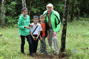 Monte Powell and local children plant trees in the Children's Eternal Rainforest in Costa Rica